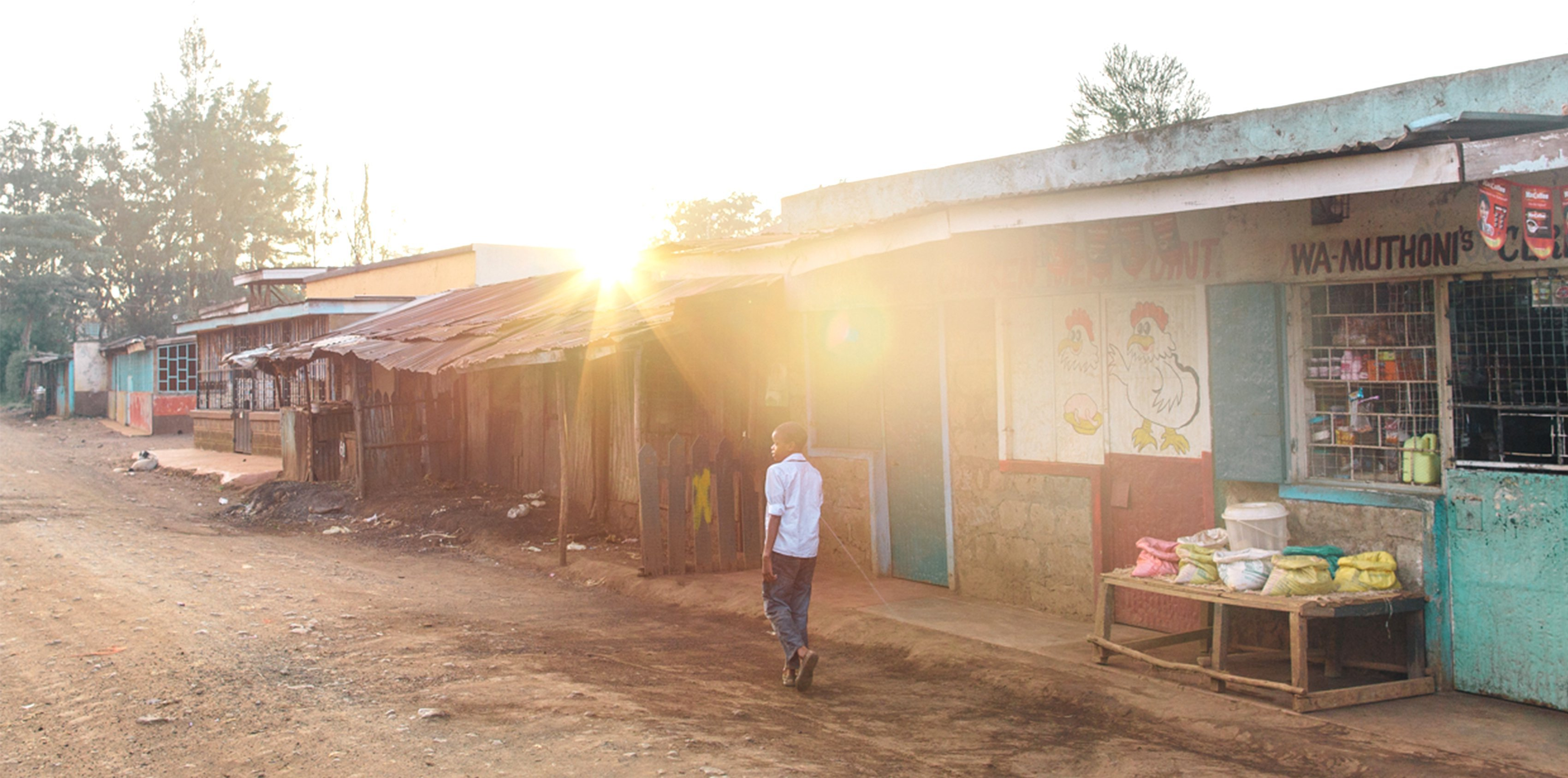 Boy walks street in Kirigu, Kenya