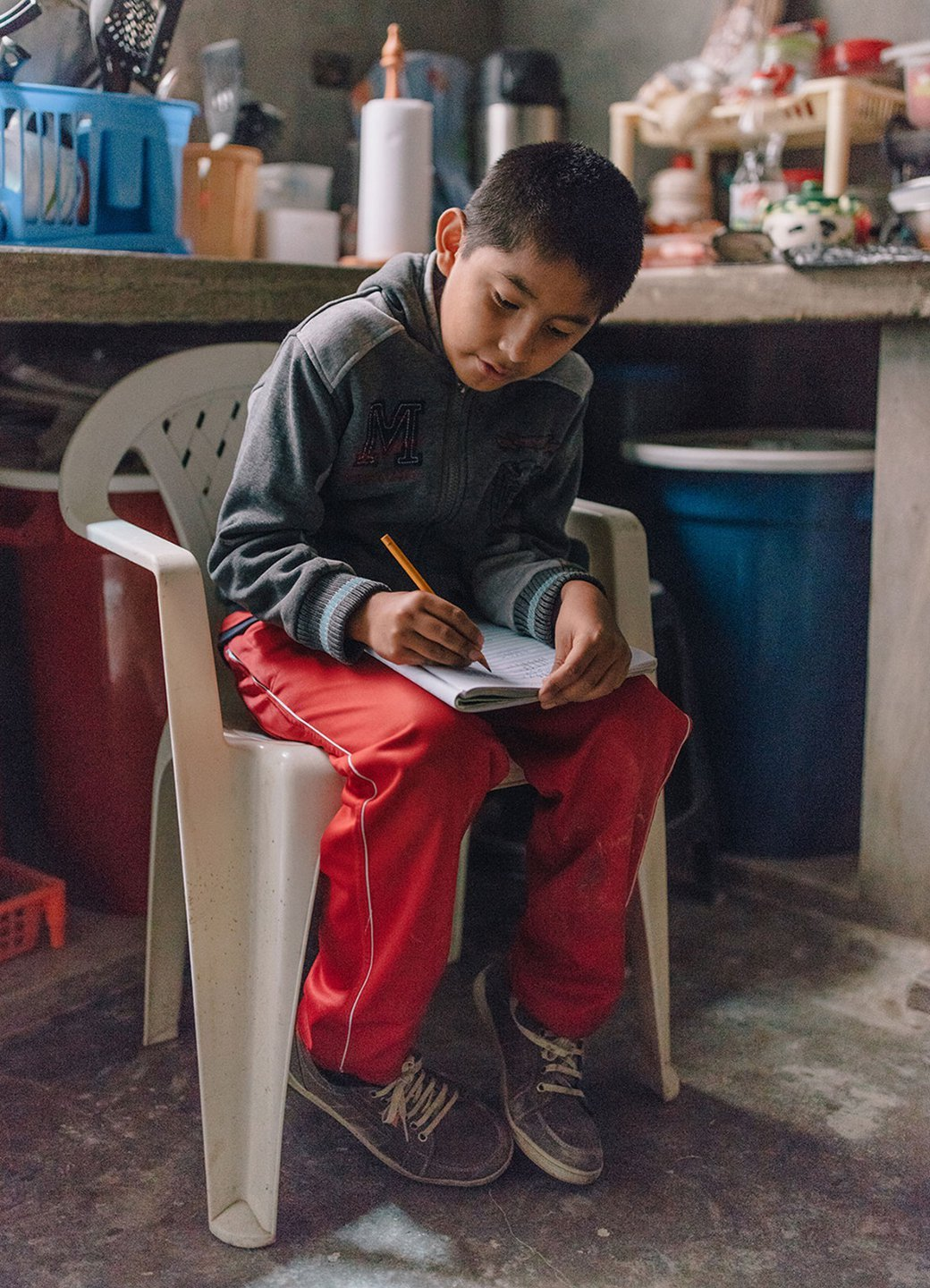 Paulo does homework in Lima, Peru